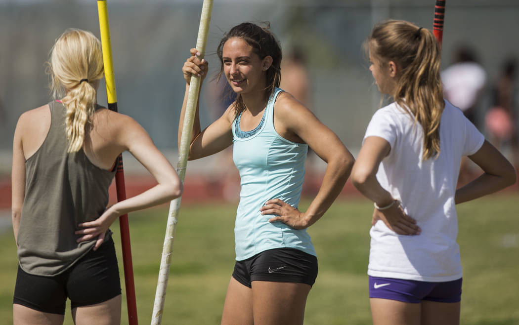 Gabby Carson, middle, one of Nevada's top prep pole vaulters, talks with teammates dur ...
