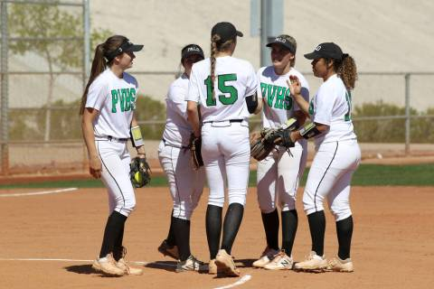 Palo Verde players gather on the mound in the first inning of their softball game against Sa ...
