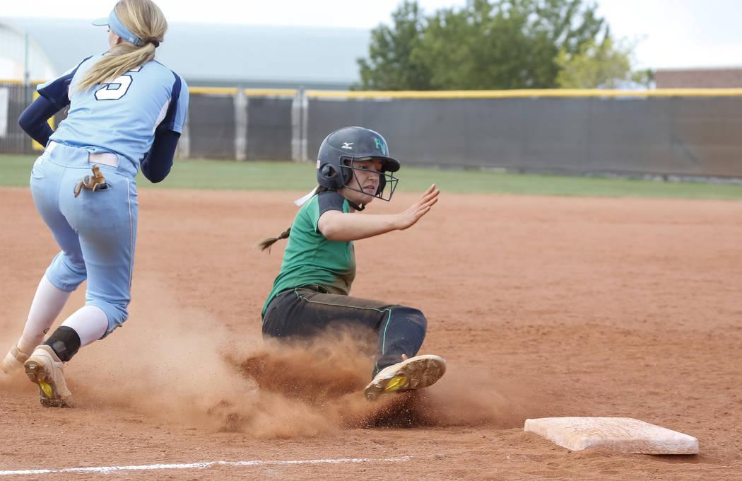 Palo Verde's Makall Whetten slides safely into third base against Centennial's S ...