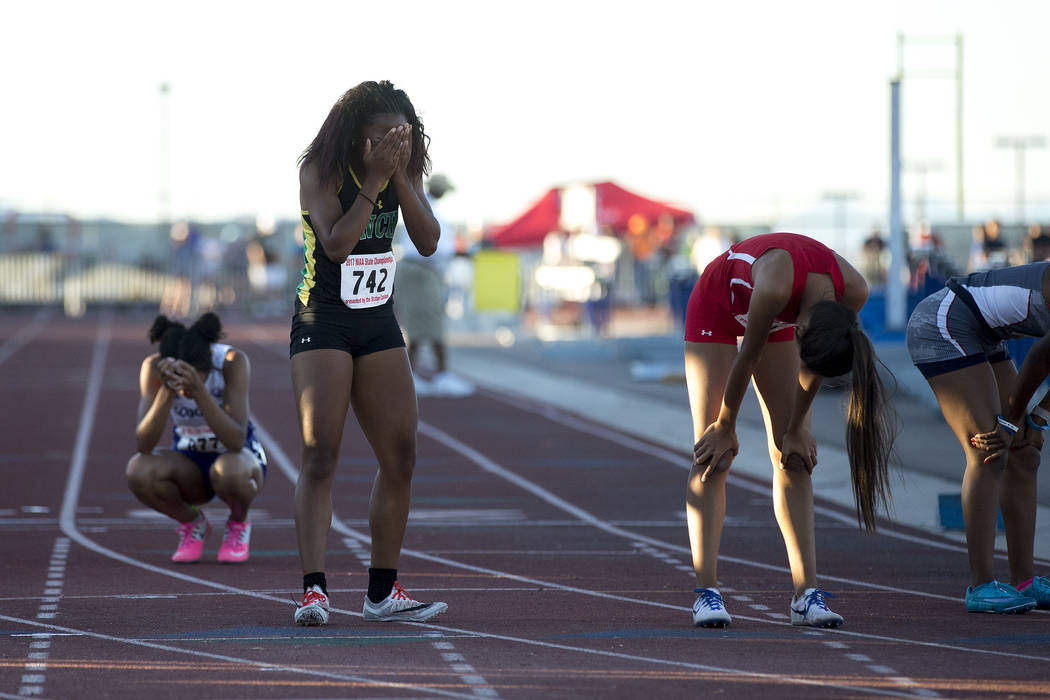 Rancho junior Gizelle Reid reacts after placing first in the girls 4A 400-meter dash at the ...