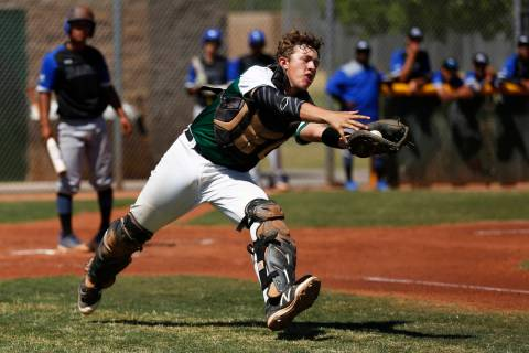 Rancho's catcher Matthew Baughn (5) catches a pop-up against Basic during the first in ...