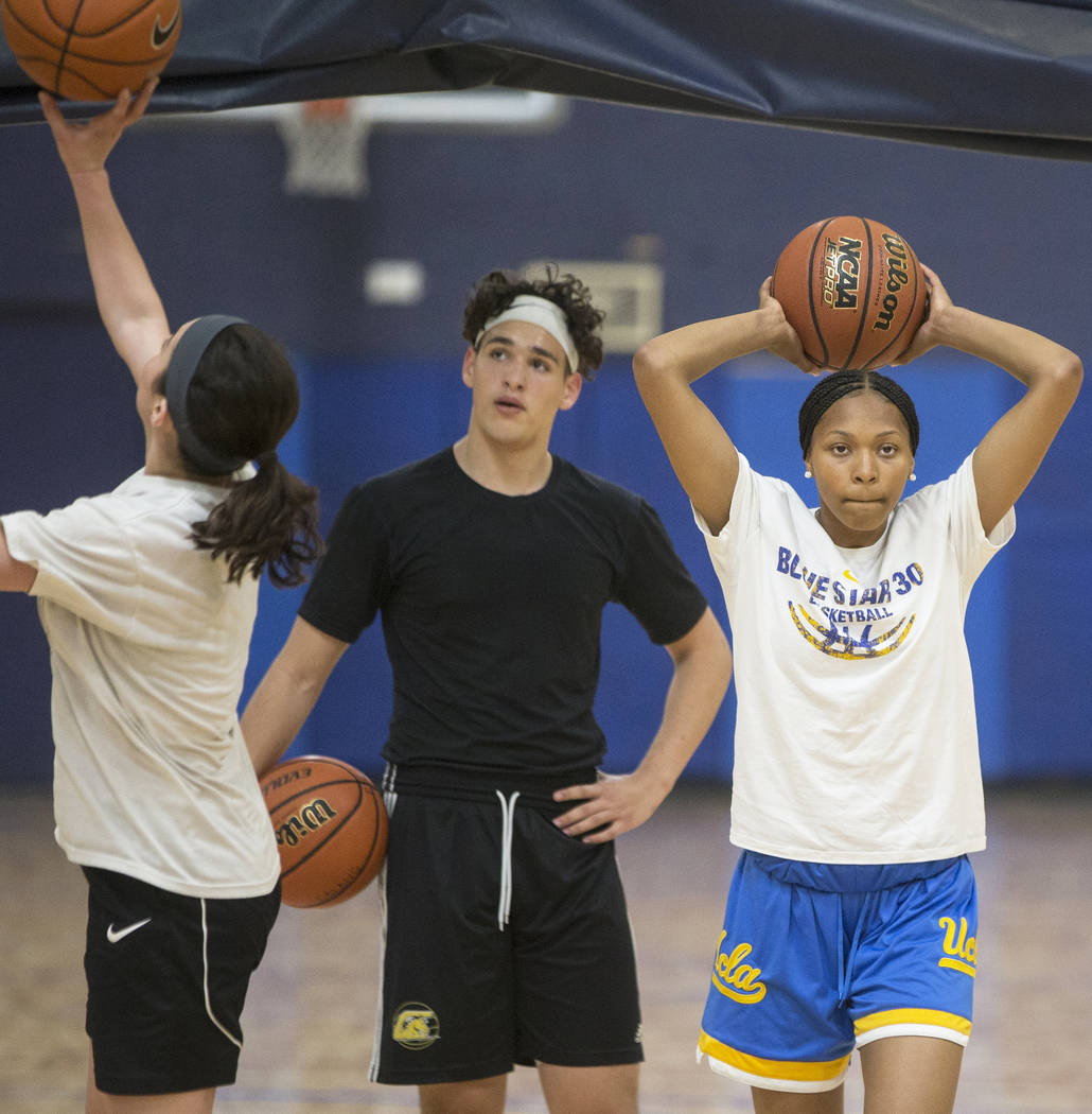 Centennial High School freshman point guard Taylor Bigby, right, works out at Tarkanian Bask ...