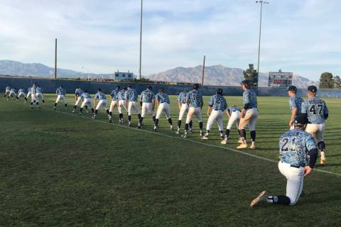 Centennial players stretch after their 11-6 home victory over Rancho in Las Vegas, Friday, M ...