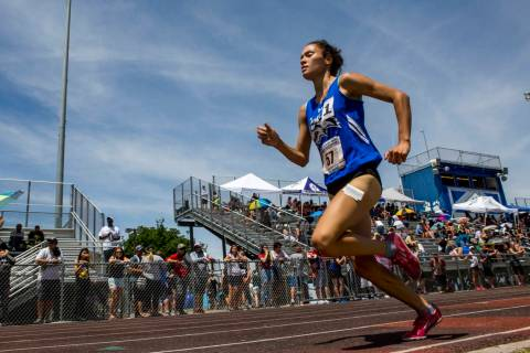 Basic junior Raquel Chavez runs in the 1,600-meter run, finishing first with a time of 5:26. ...