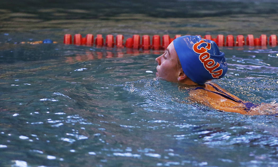Olivia Gordon, of Bishop Gorman High School, swims back towards the edge of the pool after c ...