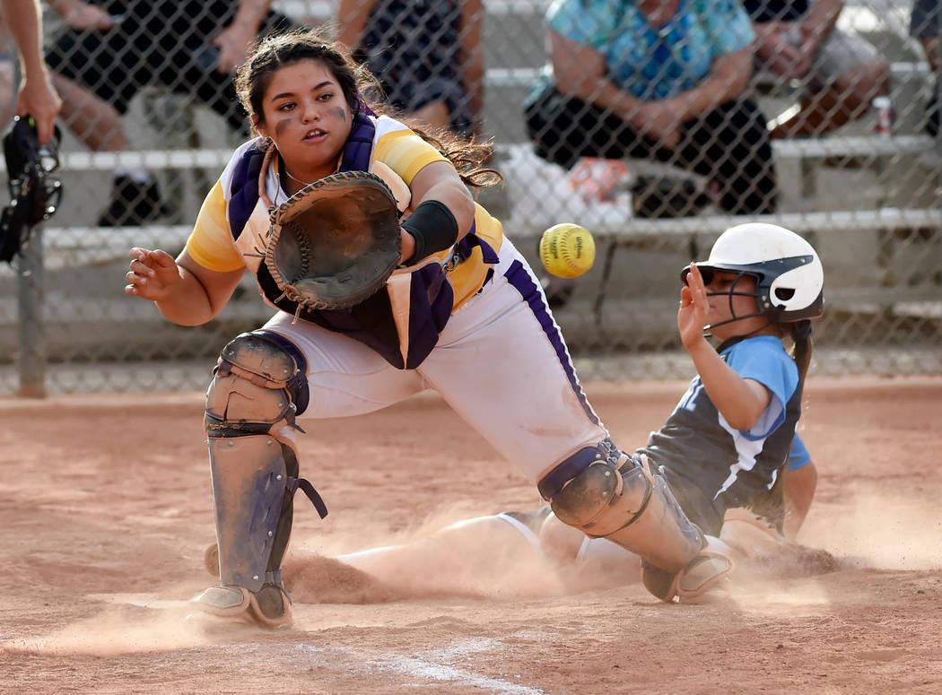 Durango catcher Alexis Geraldo looks to catch the ball as Durango's Samantha Lawrence ...