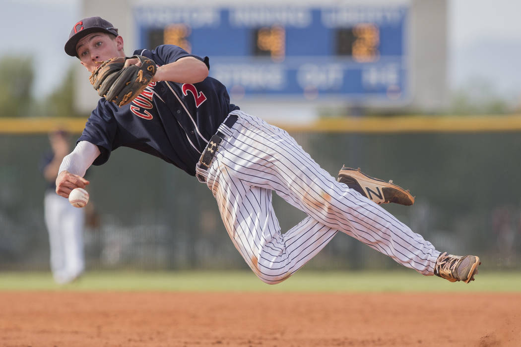 Coronado second baseman Taylor Darden (2) makes a leaping throw in the fourth inning during ...
