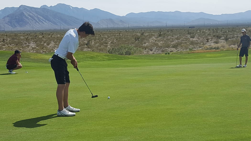 Foothill's Noah MacFawn putts on the 15th hole Tuesday during the Class 4A Sunrise Reg ...