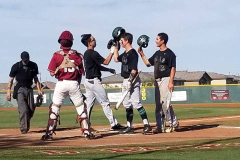Palo Verde players congratulate Tyler Kim after his two-run home run in the third inning aga ...