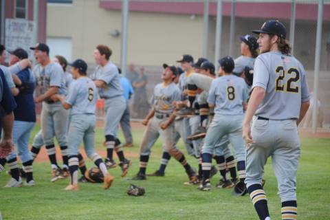 Boulder City celebrates its 4-3 come-from-behind victory over Pahrump Valley on Thursday, Ma ...