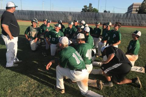 Palo Verde players meet with coach Joe Hallead after their 6-4 victory over Bishop Gorman in ...