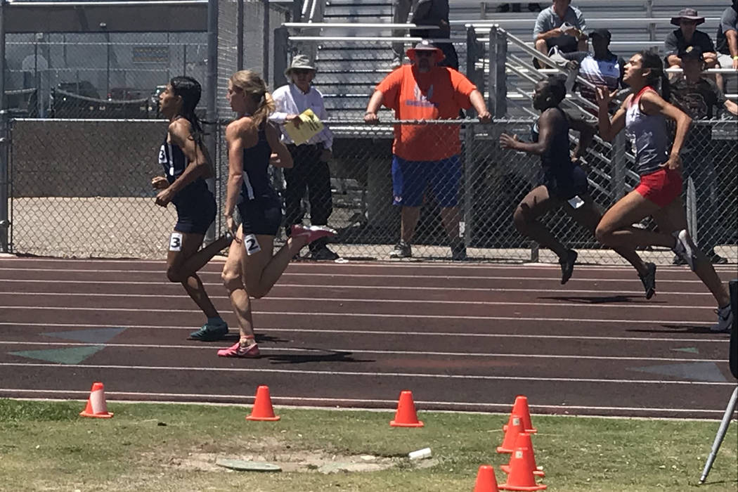 Sprinters, including Arbor View's Hannah Esparza, compete in the 200-meter dash in the ...