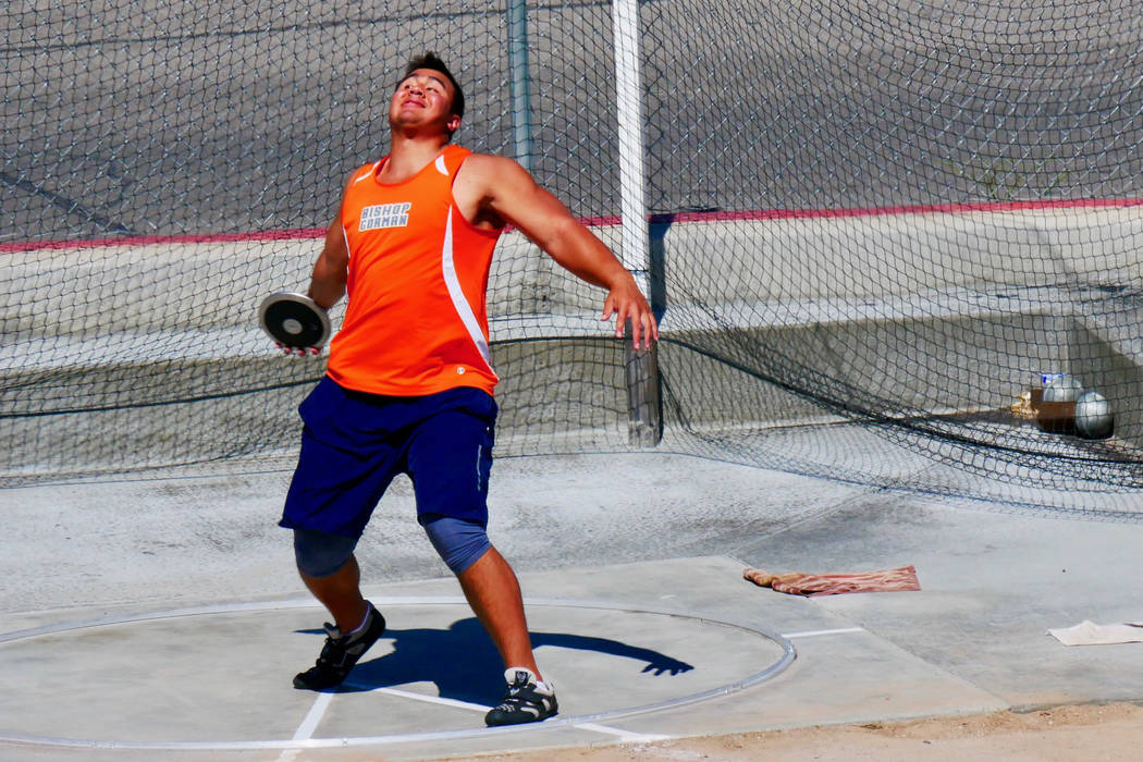 Bishop Gorman senior Jacob Isaia prepares to throw the discus in the Sunset Region track mee ...