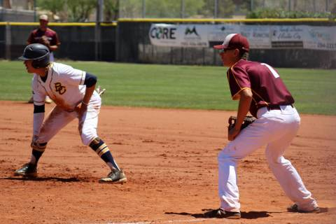 Pahrump Valley's Garrett Lucas, right, holds Boulder City's Rhett Armstrong on f ...