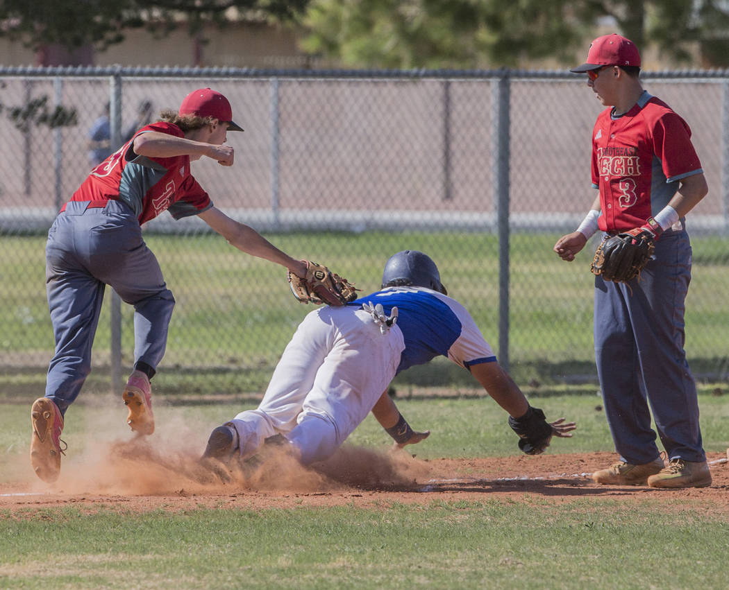 Desert Pines senior Juan Castaneda (7) is tagged out by Southeast Career Tech senior pitcher ...