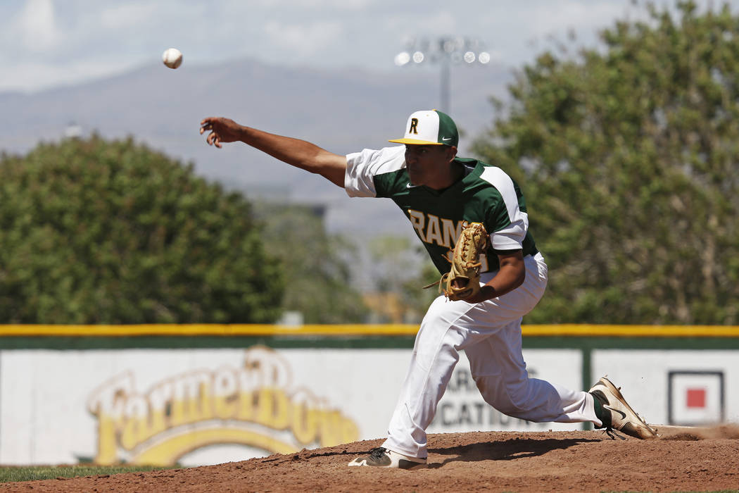 Rancho's pitcher Jimmy Gamboa (99) pitches against Basic during the fifth inning at Ra ...