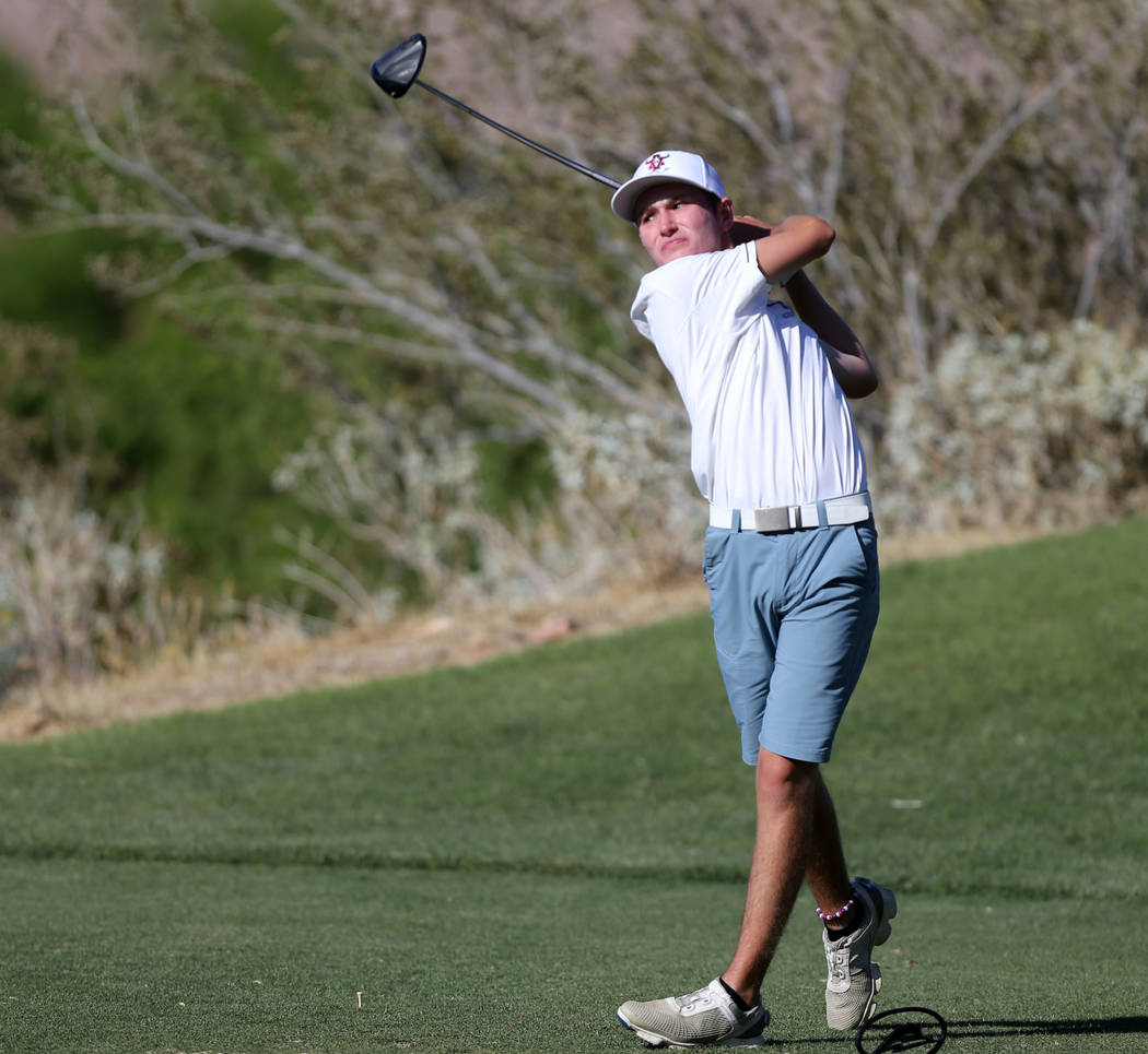 Arbor View's Cameron Gambini tees off on 14th hole at Reflection Bay Golf Club in Hend ...