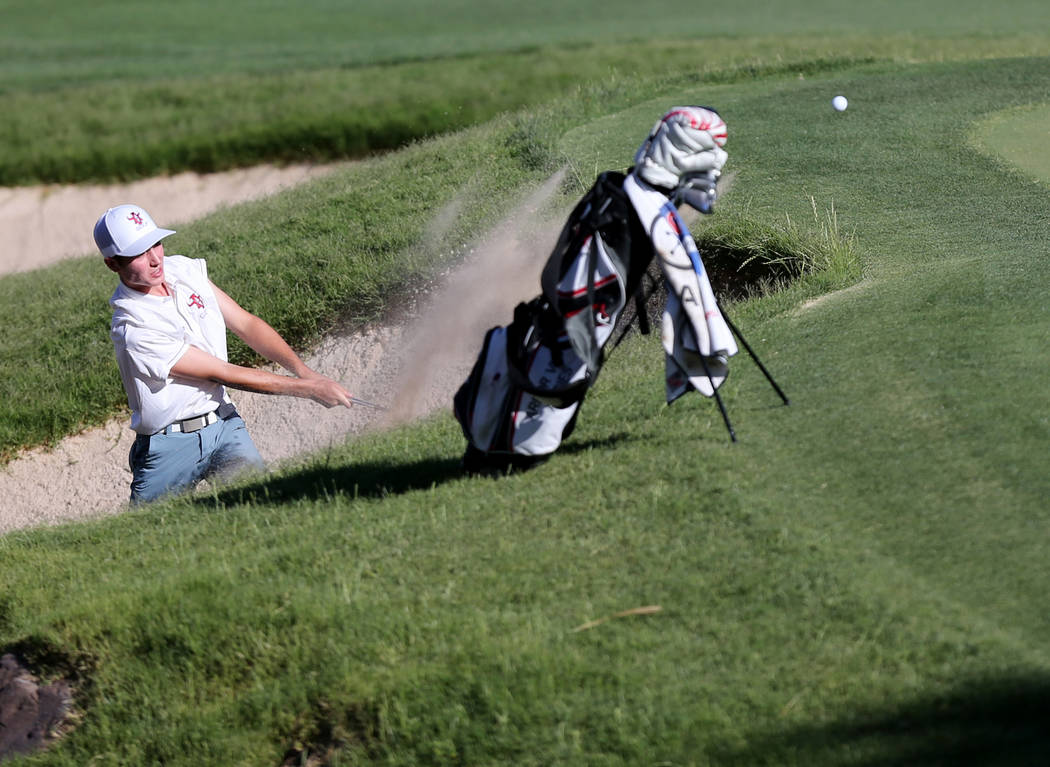 Arbor View's Cameron Gambini hits out of the sand on the 14th hole at Reflection Bay G ...