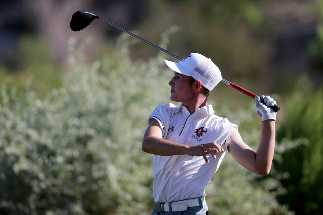 Arbor View's Cameron Gambini watches his tee shot on 15th hole at Reflection Bay Golf ...