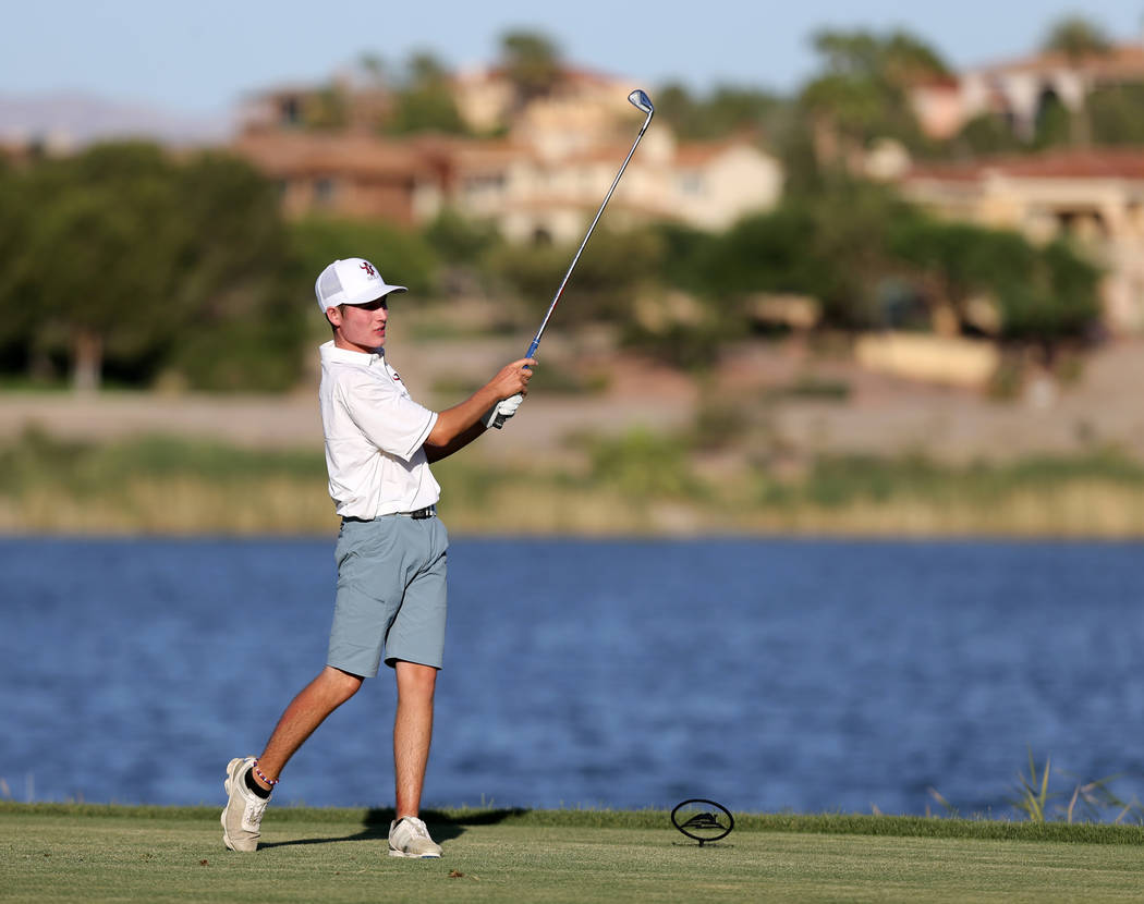 Arbor View's Cameron Gambini watches his tee shot on 18th hole at Reflection Bay Golf ...