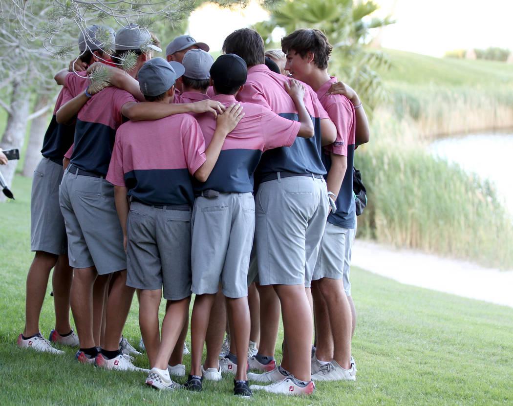 Members of the Coronado High School golf team huddle after winning the team Class 4A Nevada ...