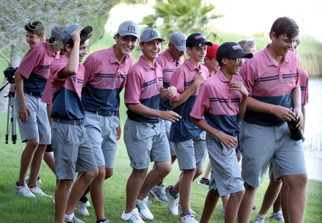Members of the Coronado High School golf team react after winning the team Class 4A Nevada s ...