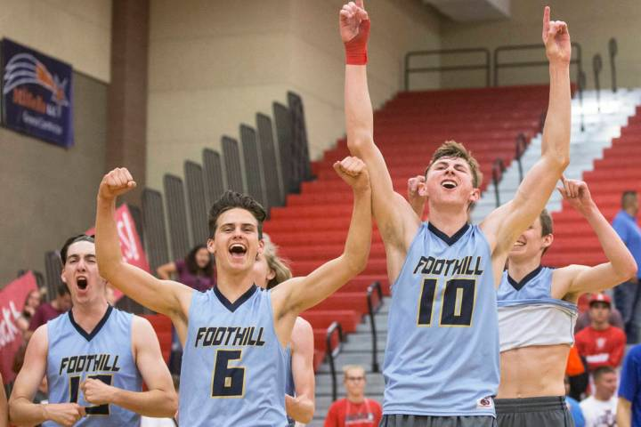 Foothill's Caleb Stearman (10), Trent Milne (6) and Sawyer Campbell (13) celebrate aft ...