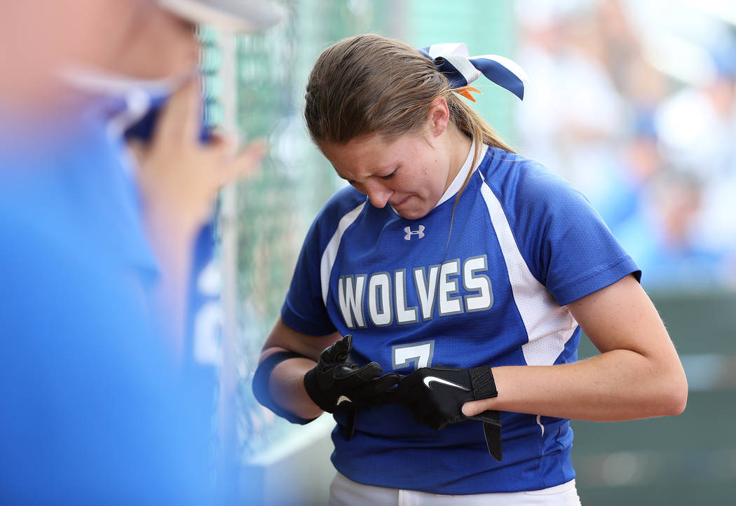 Basic Wolves' Shelby Basso reacts to making the final out against the Douglas Tigers i ...