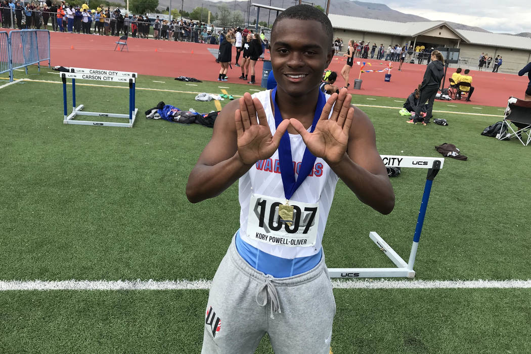 """Western senior sprinter Korey Powell-Oliver forms a """"W"""" with his hands after win ..."""