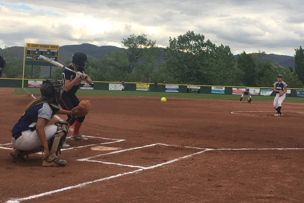 Shadow Ridge's Mia Voges pitches to a Douglas hitter in a Class 4A state softball tour ...