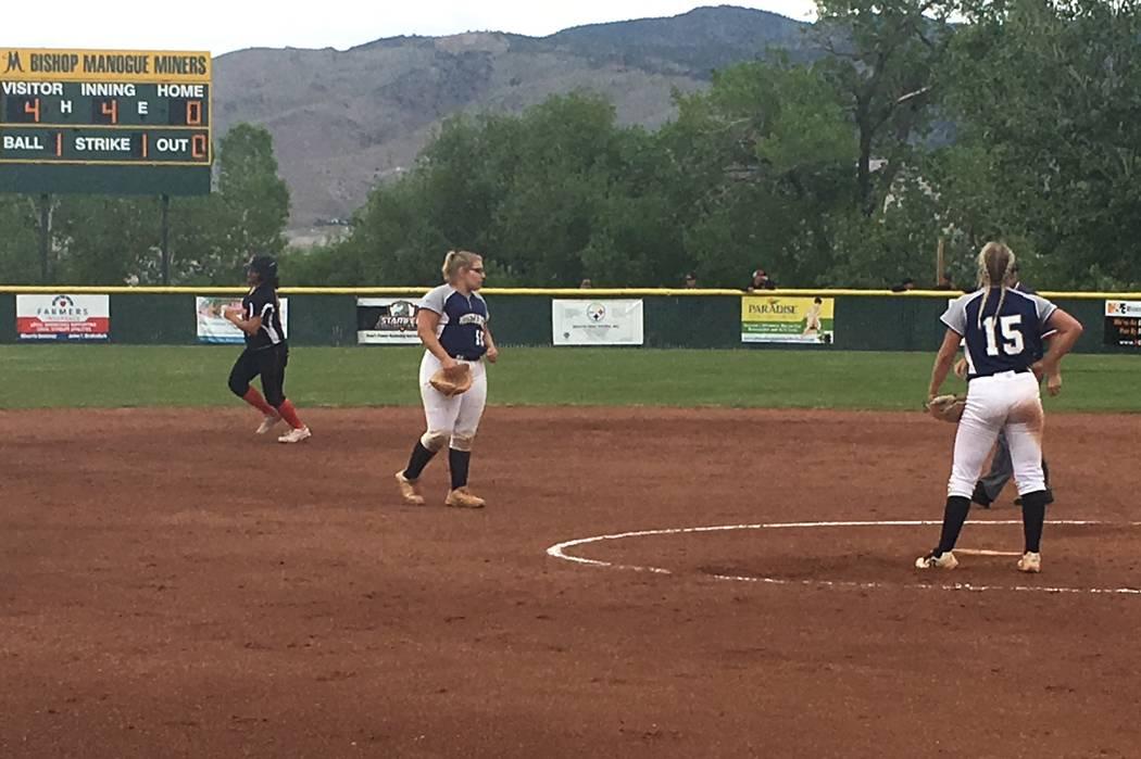 Shadow Ridge players react to a home run against Douglas in a Class 4A state softball tourna ...