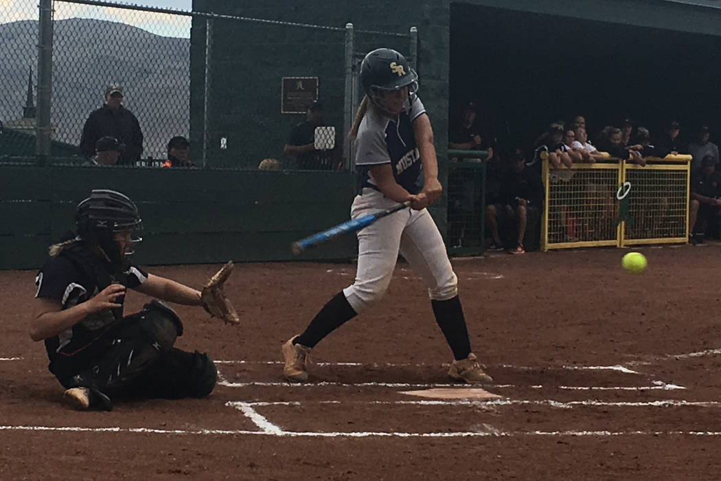 Shadow Ridge's Caitlyn Covington swings at a pitch from Douglas in a Class 4A state so ...