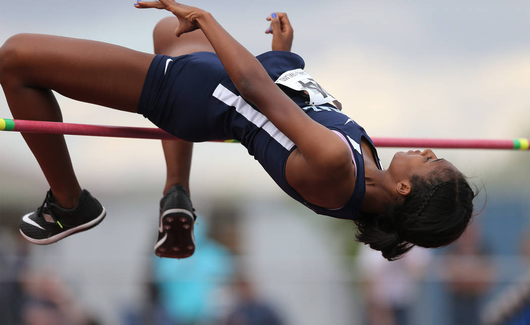 Centennial's Anyese James-Kirkland competes in the high jump at the NIAA Track & F ...