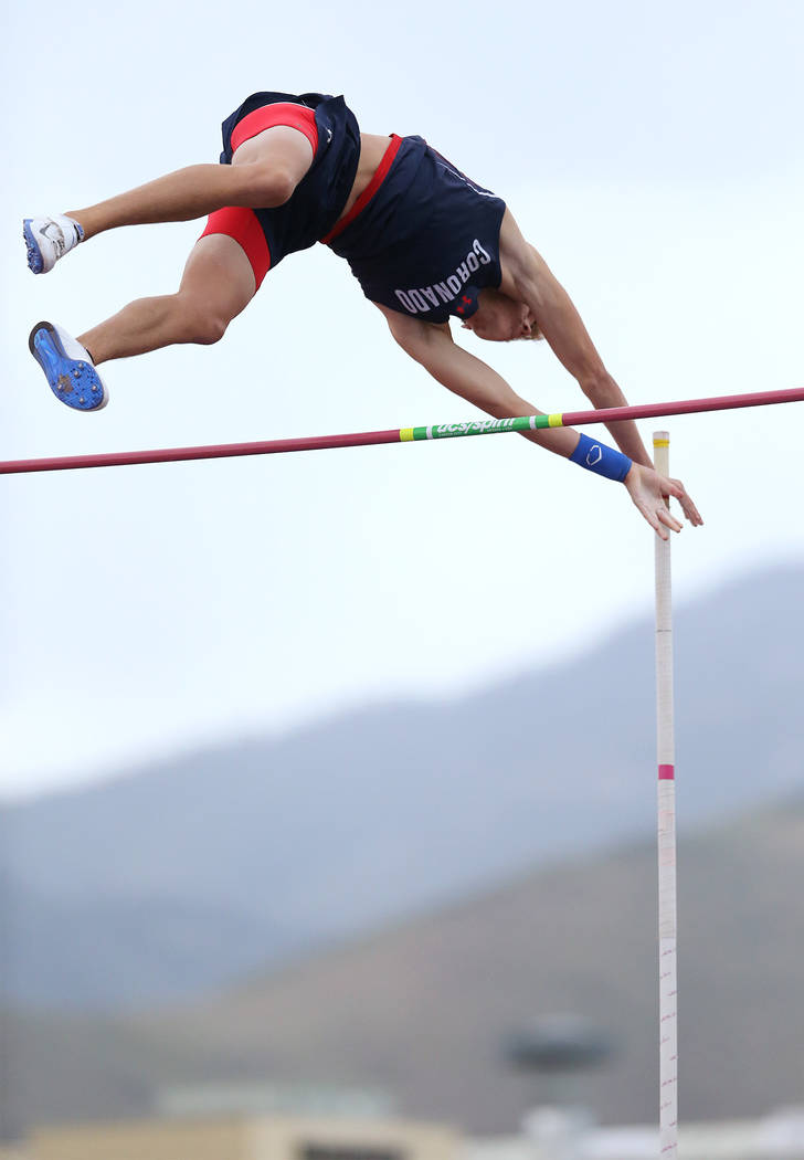 Coronado's Keaton Daniel clears 15-0 in the pole vault to tie for the title at the NIA ...