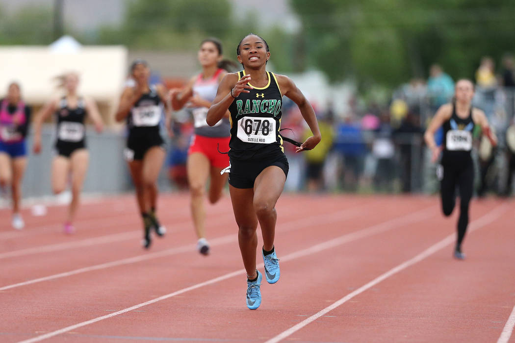 Rancho's Gizelle Reid wins the 4A 400 at the NIAA Track & Field Championships at ...