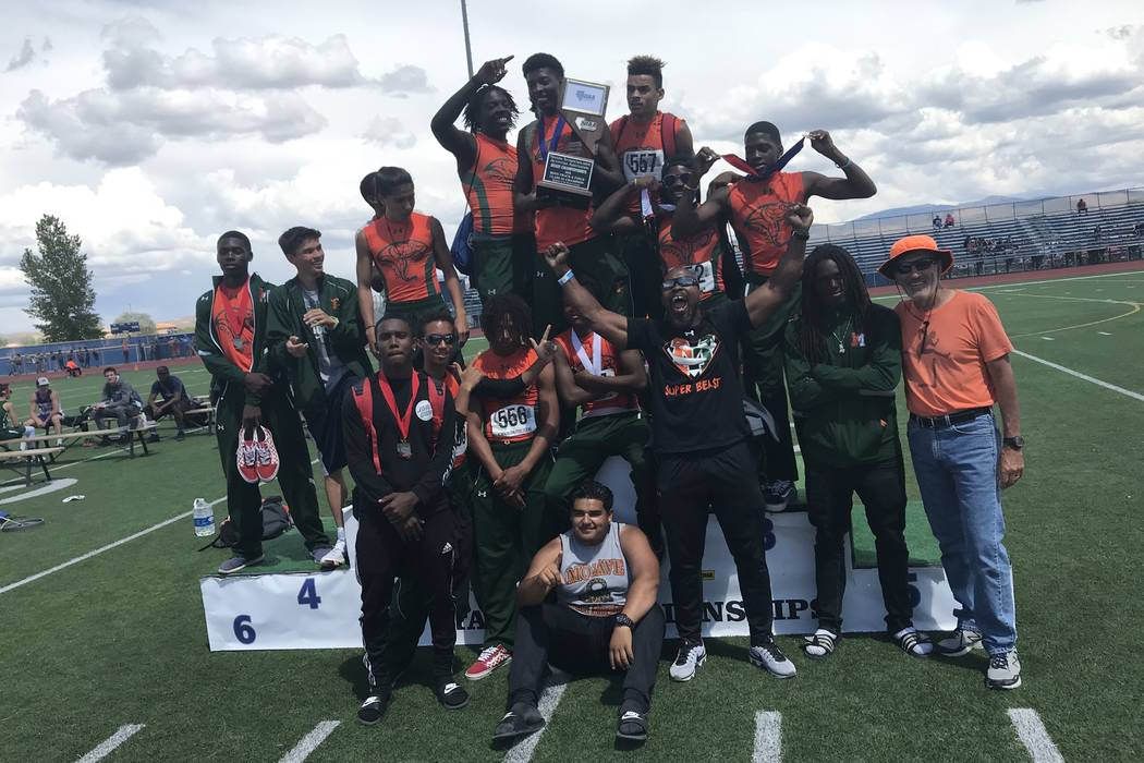 Mojave's boys track and field celebrates its Class 3A state championship victory on Sa ...