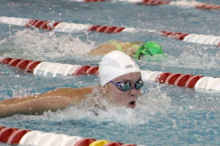 Green Valley's Liz Clinch competes in the 100 butterfly during the Class 4A state cham ...