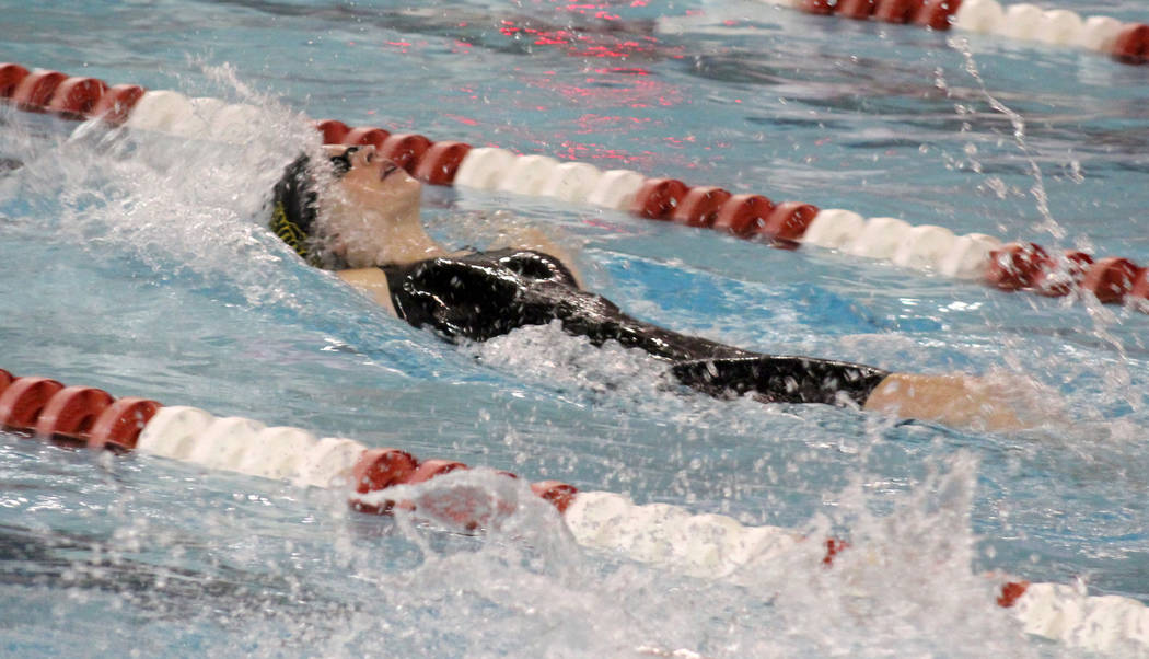 Del Sol's Brynn Sproul competes in the 100 backstroke at the Class 3A state swimming c ...