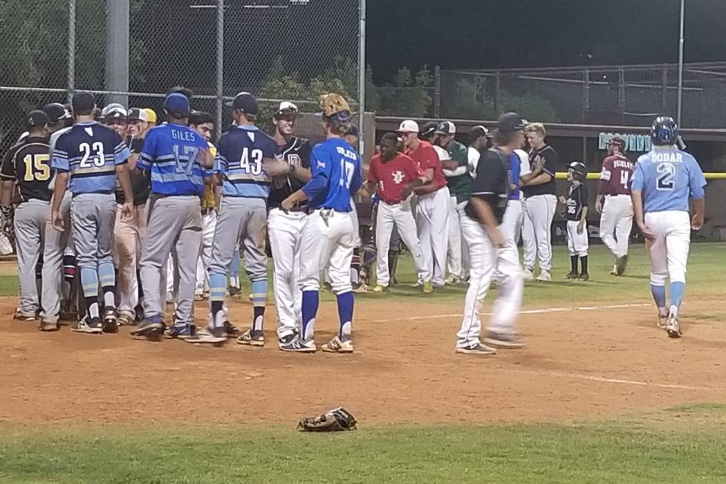 Players shake hands following the Class 4A Senior All-Star Game at Faith Lutheran on Thursda ...