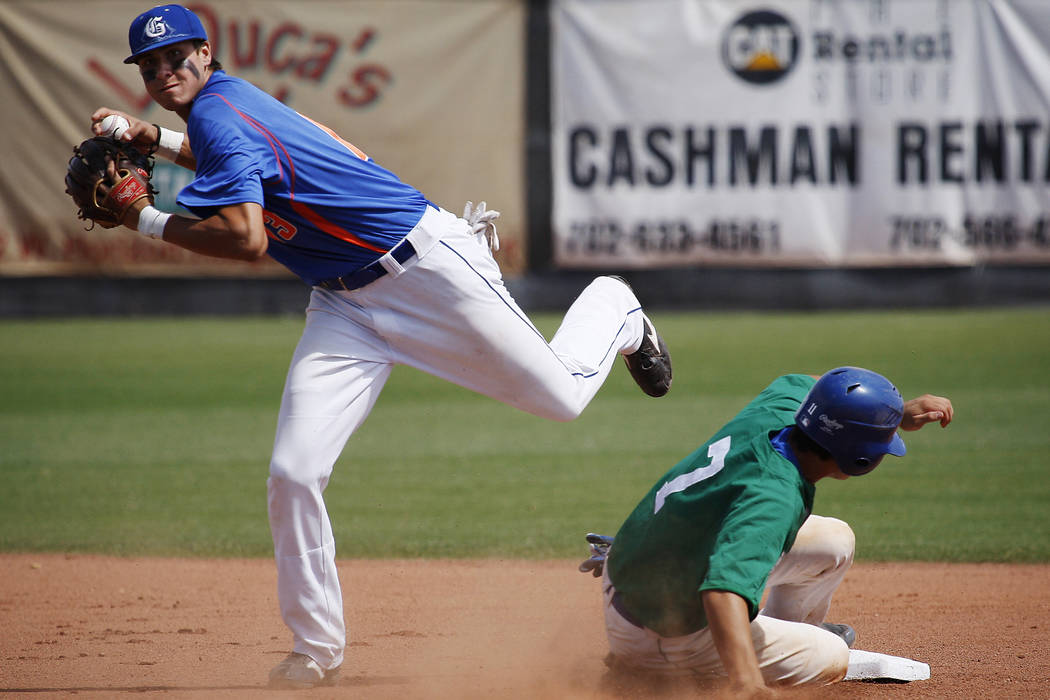 Bishop Gorman's Joey Gallo looks to turn a double play as Green Valley's Even Va ...