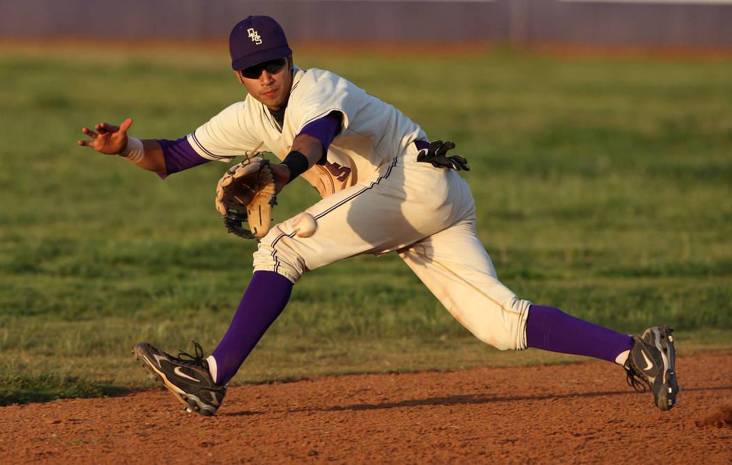 Durango High School baseball player Niko Vasquez fields a ground ball during a baseball game ...
