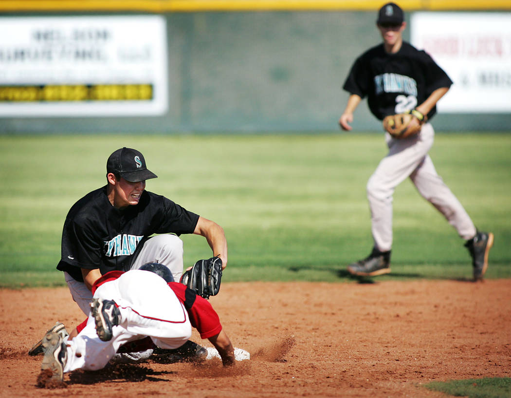 Las Vegas High School baseball player Timothy Daniel gets picked off by Silverado shortstop ...