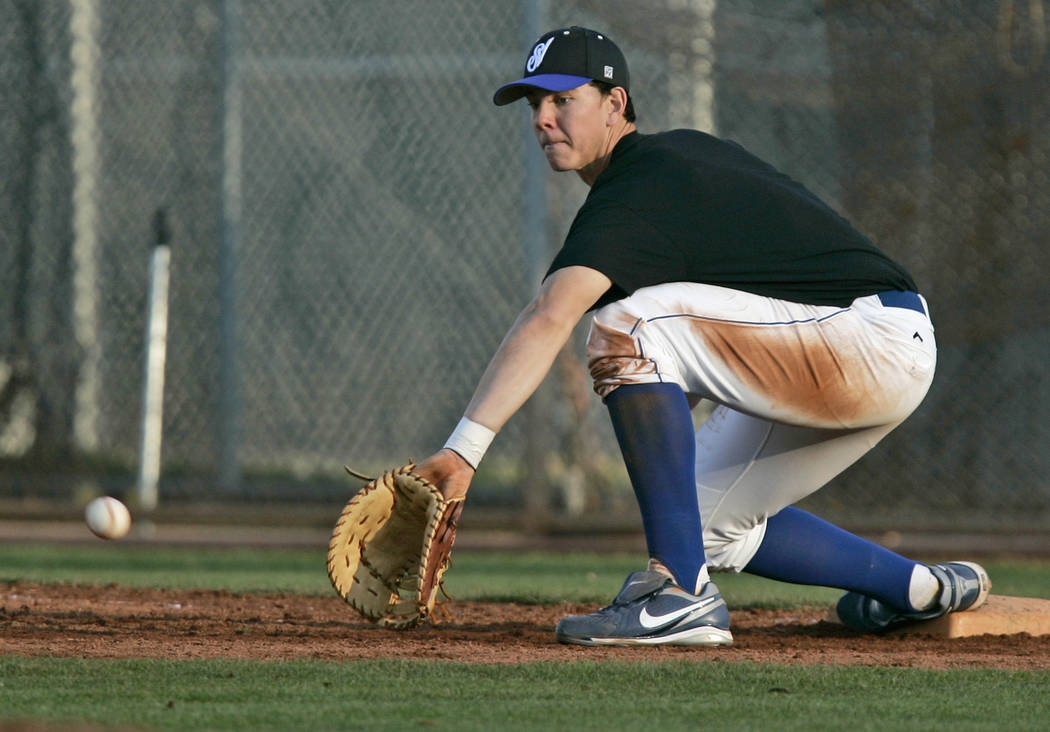 Sierra Vista High School baseball player Nick Kingham makes a catch at first base for an out ...