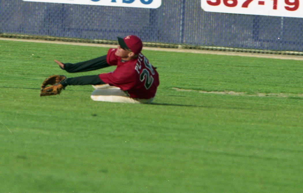 Las Vegas High's Anthony Pluta dives for a ball in the outfield. (Review-Journal file ...