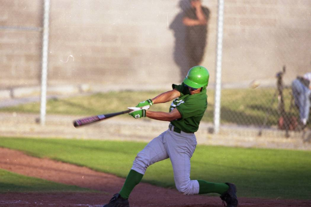Green Valley's Dave Krynzel takes a swing against Silverado at Green Valley High Schoo ...