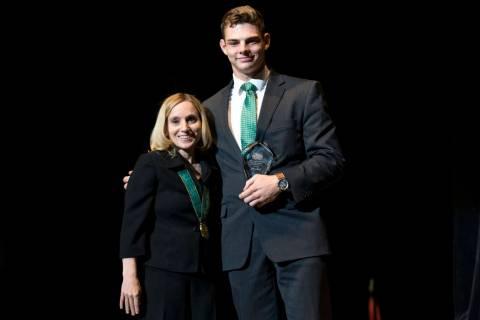 Olympic gold medalist Kerri Strug, left, poses withJayden Perkins, Virgin Valley High ...