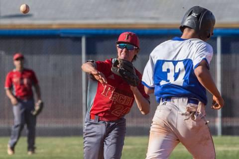 Southeast Career Tech sophomore second baseman Jason Collingbourne (24) turns a double play ...