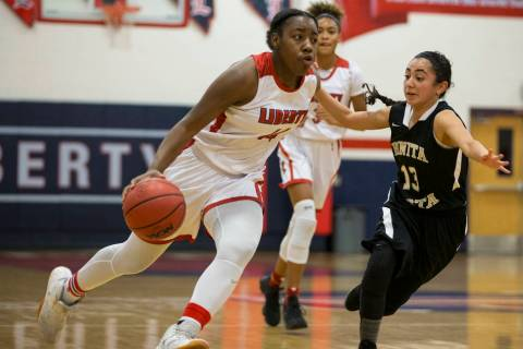 Liberty's Dre'una Edwards (44) runs the ball against Bonita Vista in the girl&#8 ...