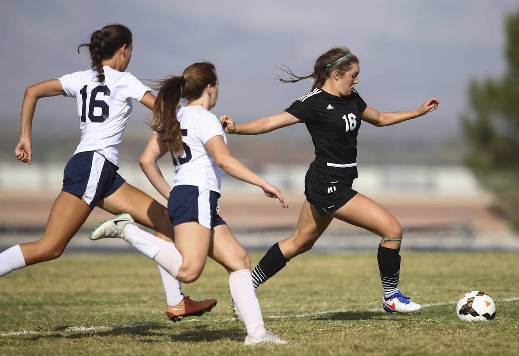 Palo Verde's Olivia Packer, right, moves the ball past Centennial's Savannah Tar ...