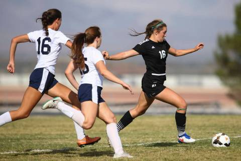 Palo Verde's Olivia Packer, right, moves the ball past Centennial's Savannah Tar ...